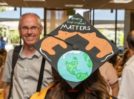 "Student's decorated cap says ""every individual matters"""