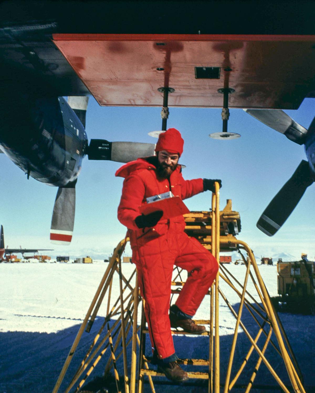 Nils Sko checking on radar antenna on c-130 plane