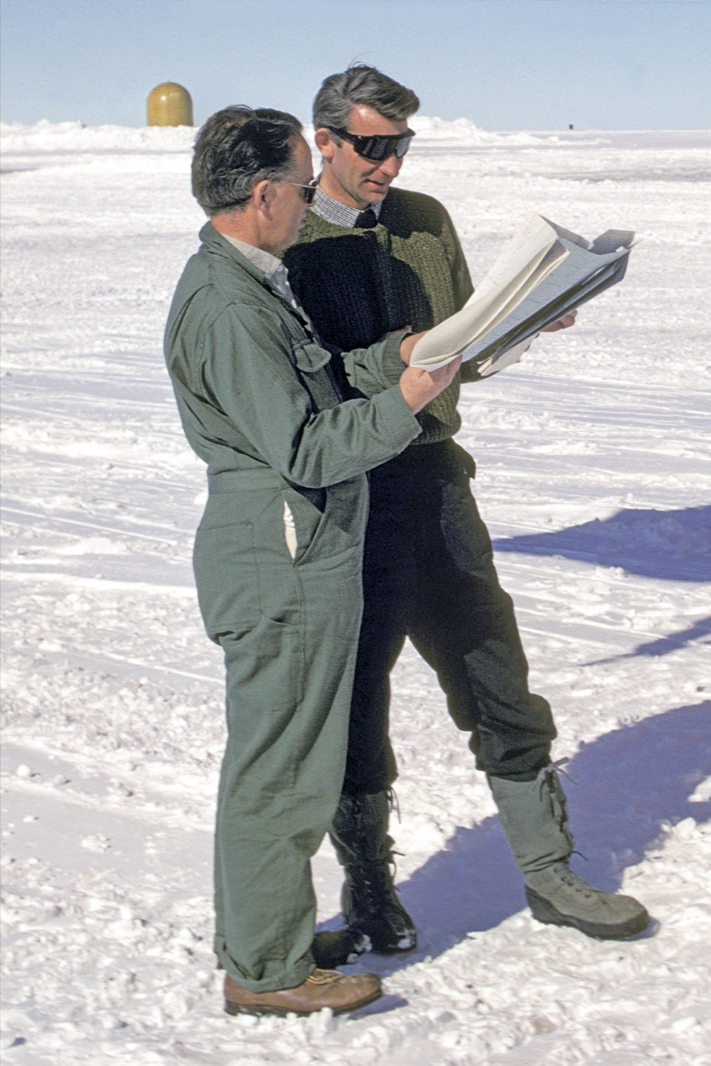 Gordon Robin and Stan Evans discussing flight plans