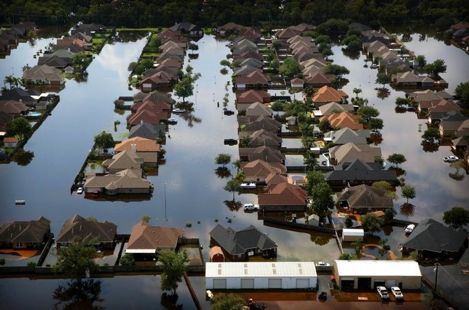 Flooding south of Houston in September in the wake of Hurricane Harvey (Credit Barbara Davidson for The New York Times)