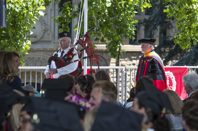Bagpiper Marty Cawthon leads the procession.