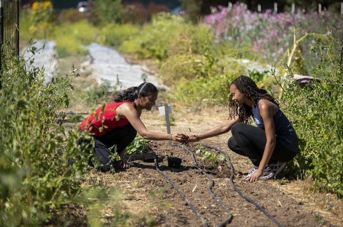 Suchana Costa and Carmen Smith work on the Farm.