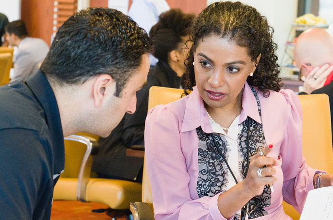 Image of a man and a woman talking during the course.