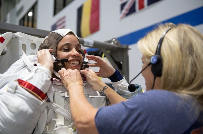 Jessica Watkins putting on spacesuit