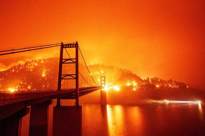 fire on hill by bridge