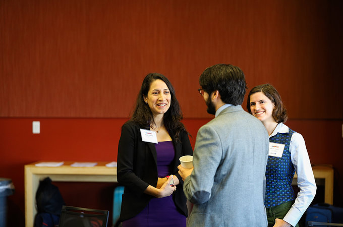 Lupe Carrillo speaking with Stanford Earth graduate student Ginny Isava (right) and another graduate student