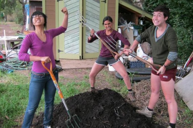 students turning compost