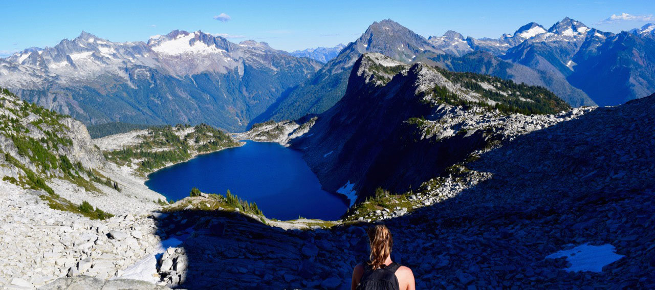 Girl overlooking mountain lake