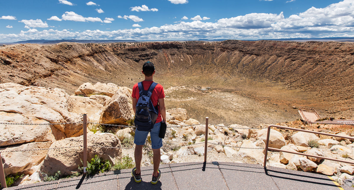 Man overlooking Meteor Crater in Arizona.