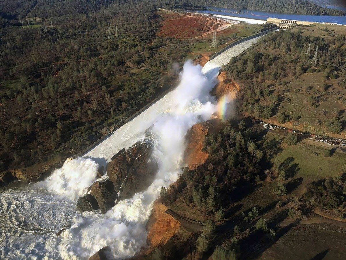 Water flowing from eroded spillway of dam