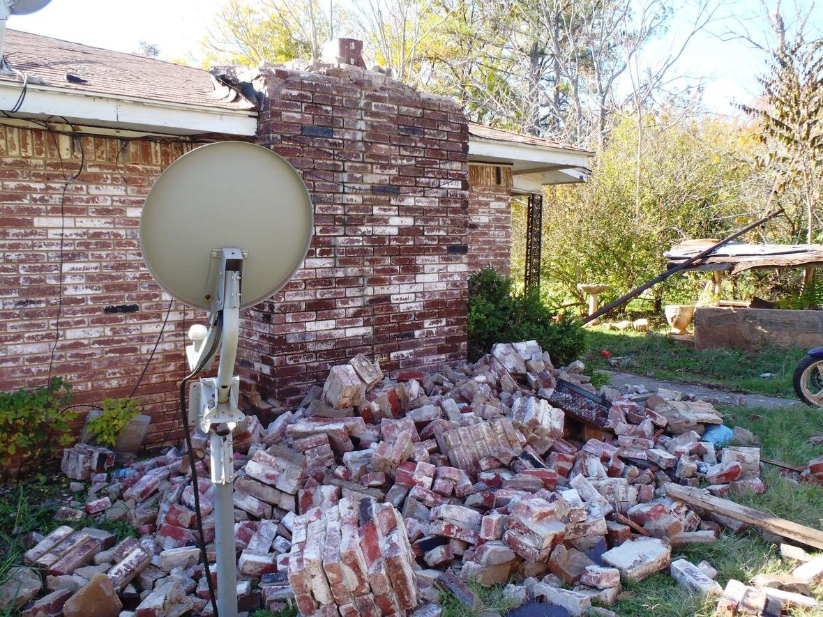 A collapsed brick wall