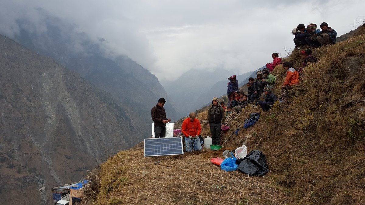Group sitting on a hillside