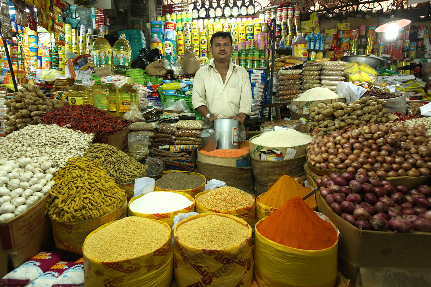 Merchant displaying spices