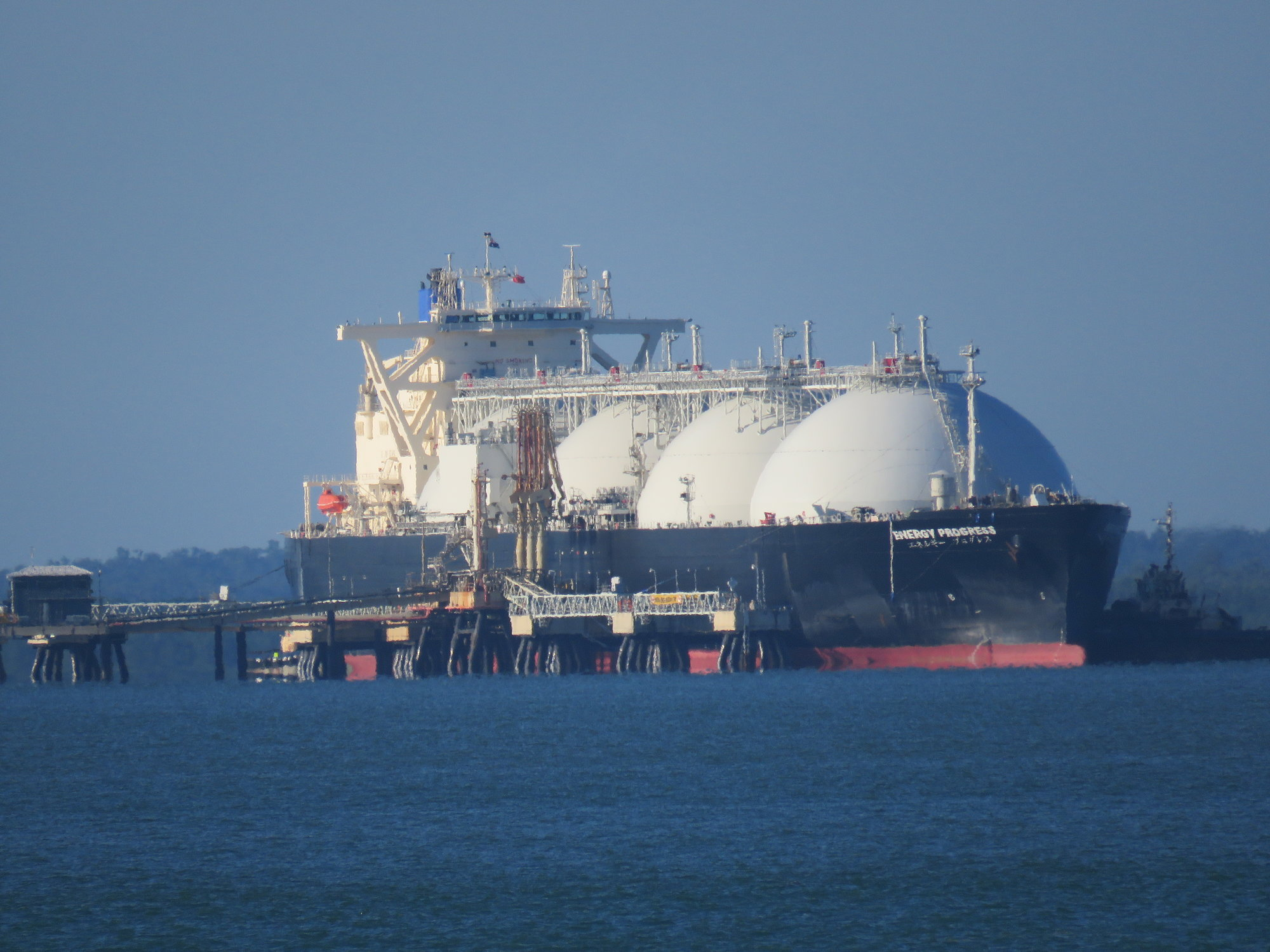 A liquified natural gas tanker at dock.