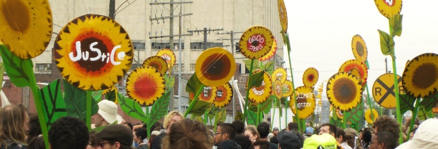 Signs being displayed during an environmental justice march.