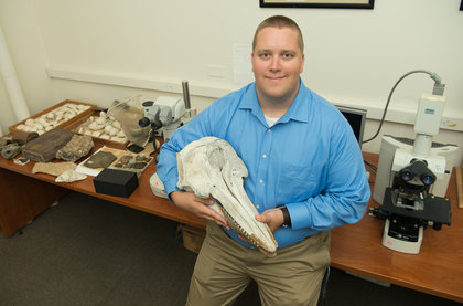 Will Gearty with a dolphin skull