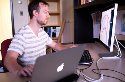 Ossian on two computers, Photo credit: Ker Than