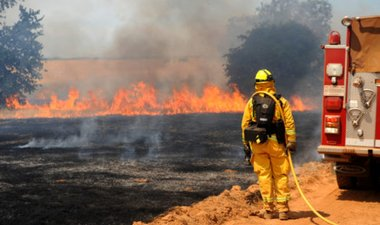 Firefighter monitors prescribed burn