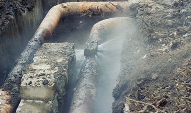Broken pipe with water spraying