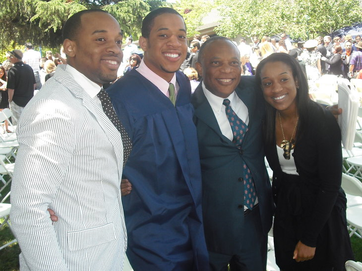 Usua and his family at high school graduation.